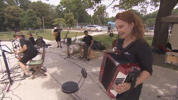 Donna Garner, shown playing the accordion, is artistic director for Garner Theatre Productions, which is hosting a series of performances this weekend at Monarch Park. (CBC - image credit)