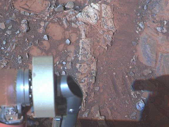 """The pale rock in the upper center of this image, about the size of a human forearm, includes a target called """"Esperance,"""" which was inspected by NASA's Mars Exploration Rover Opportunity. This image is a composite of three exposures taken by Op"""