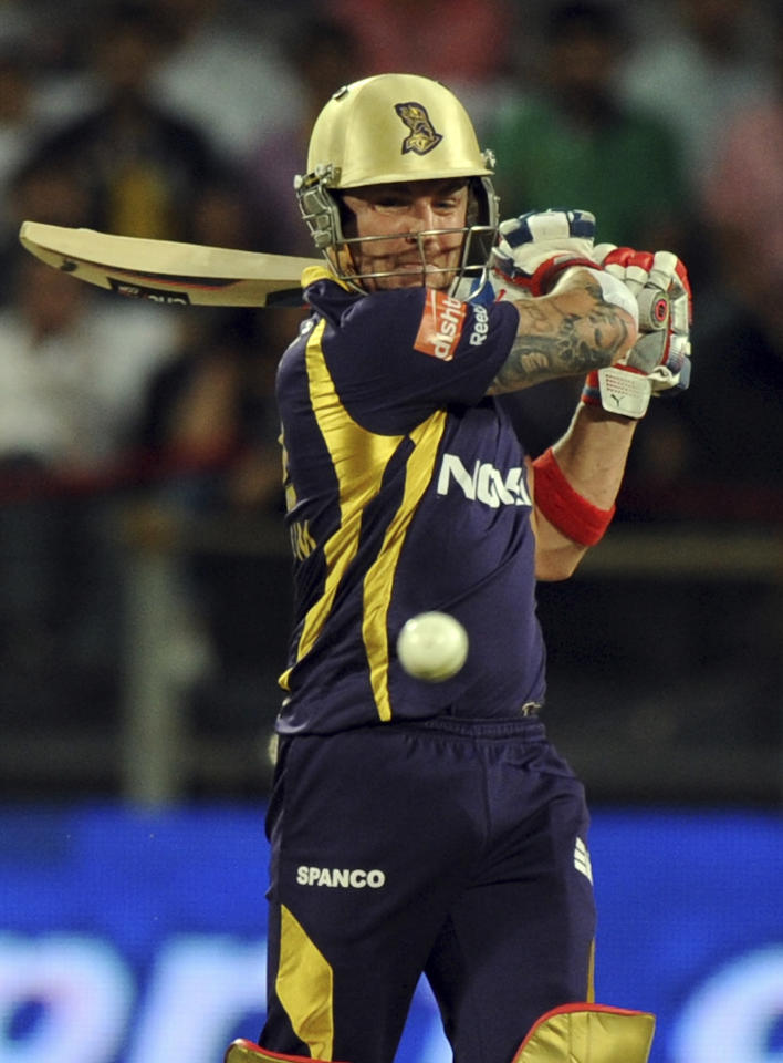 Kolkata Knight Riders batsman Brendon McCullum plays a shot during the IPL Twenty20 first playoff cricket match between Delhi Daredevils and Kolkata Knight Riders at The Subrata Roy Sahara Stadium in Pune on May 22, 2012.  RESTRICTED TO EDITORIAL USE. MOBILE USE WITHIN NEWS PACKAGE    AFP PHOTO/Indranil MUKHERJEE        (Photo credit should read INDRANIL MUKHERJEE/AFP/GettyImages)