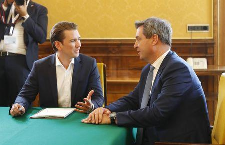 Austria's Chancellor Sebastian Kurz talks with Bavaria's Prime Minister Markus Soeder on occasion of a joint cabinet meeting in Linz, Austria, June 20, 2018. REUTERS/Leonhard Foeger
