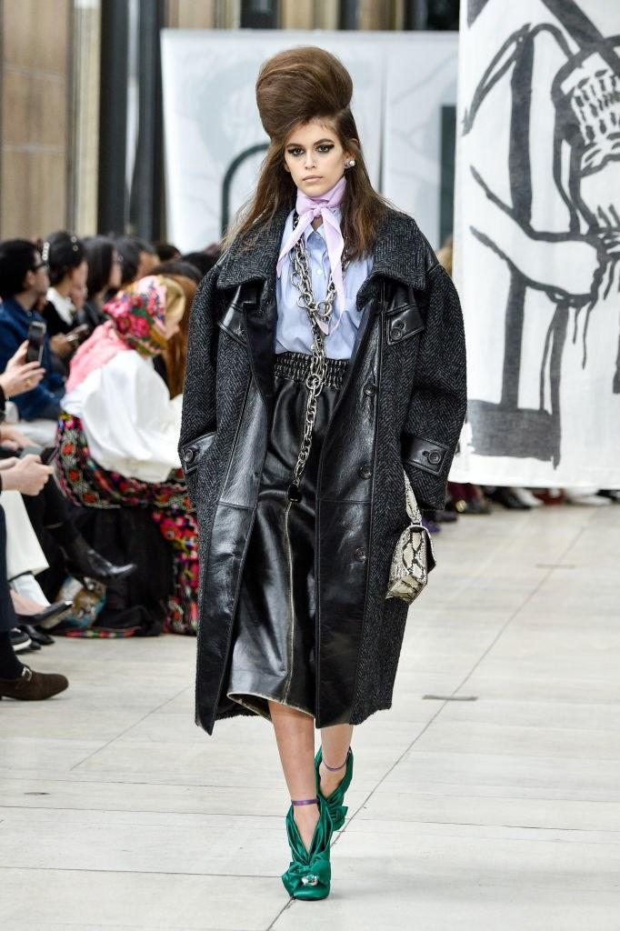 Kaia Gerber walks the runway during the Miu Miu Fall 2018 show as part of Paris Fashion Week on March 6, 2018 in Paris, France. Photo courtesy of Getty Images.