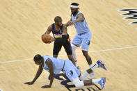 Phoenix Suns guard Chris Paul, top left, handles the ball against Memphis Grizzlies forward Justise Winslow (7) and center Gorgui Dieng, bottom, in the first half of an NBA basketball game Saturday, Feb. 20, 2021, in Memphis, Tenn. (AP Photo/Brandon Dill)