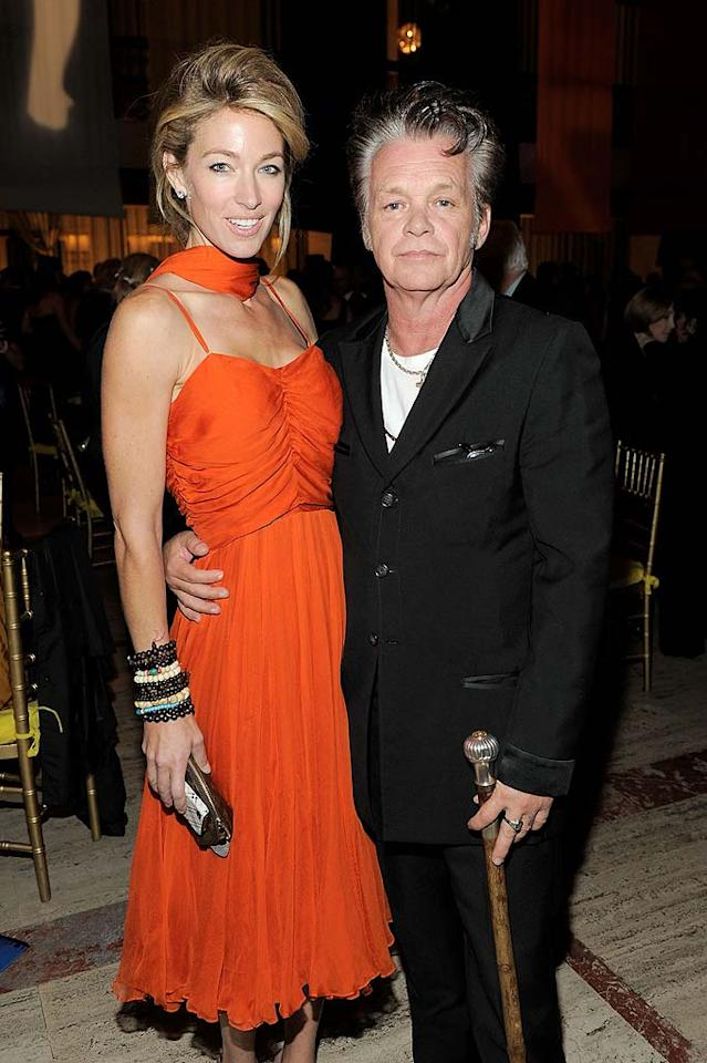 "John Mellencamp and his wife of 20 years, model Elaine Mellencamp, announced they were calling it quits on December 31, 2010. A spokesman for the couple noted that they were ""proud of their 20 years together and happy with their accomplishments both as parents and as a family."" One week later, the Indiana rocker was spotted hanging with Meg Ryan in NYC."
