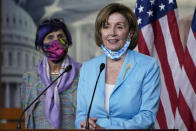 House Speaker Nancy Pelosi of Calif., right, standing with Rep. Rosa DeLauro, D-Conn., left, talks to reporters on Capitol Hill in Washington, Wednesday, May 19, 2021, about legislation to create an independent, bipartisan commission to investigate the Jan. 6 attack on the United States Capitol Complex. (AP Photo/Susan Walsh)
