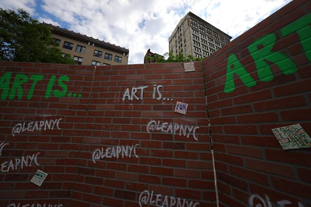 <p>A temporary wall on display for the LEAP Public Art Program's citywide exhibition show in Union Square Park in New York City on June 5, 2018. (Photo: Gordon Donovan/Yahoo News) </p>