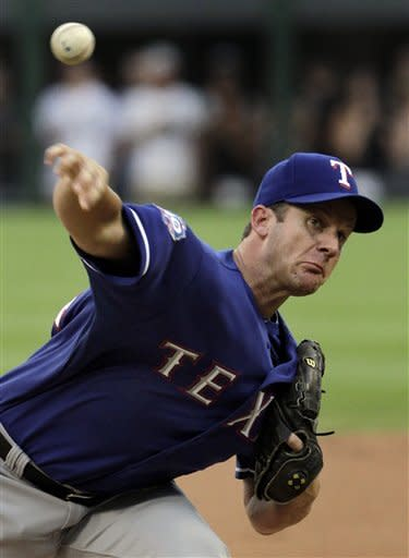 Texas Rangers starting pitcher Roy Oswalt throws to a Chicago White Sox batter during the first inning of a baseball game, Tuesday, July 3, 2012, in Chicago. (AP Photo/John Smierciak)