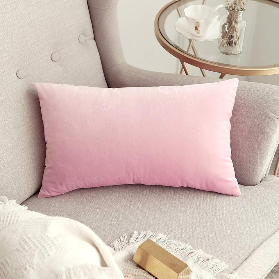 <p>This <span>Miulee Decorative Velvet Pillow Cover</span> ($8) will add a playful pop of pink to any furniture that it's on.</p>