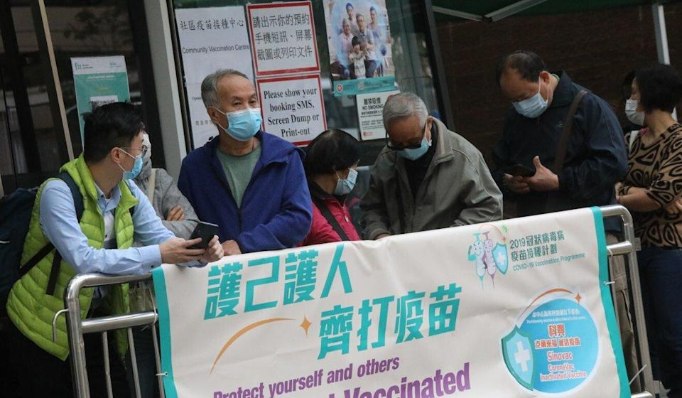 The elderly queue up for their jabs at a vaccination centre in Tin Shui Wai. Photo: K. Y. Cheng