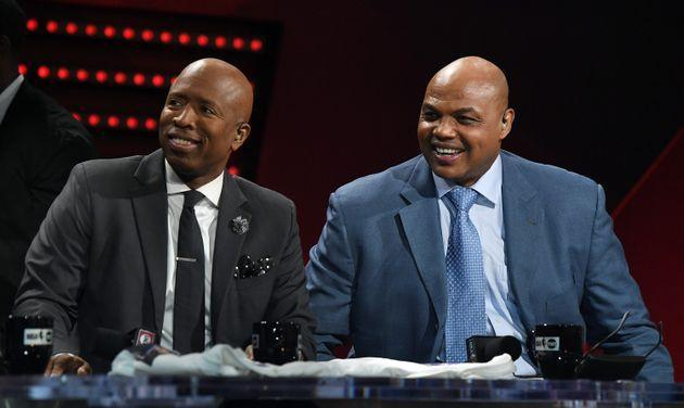 NBA analysts Kenny Smith and Charles Barkley laugh during a live telecast of