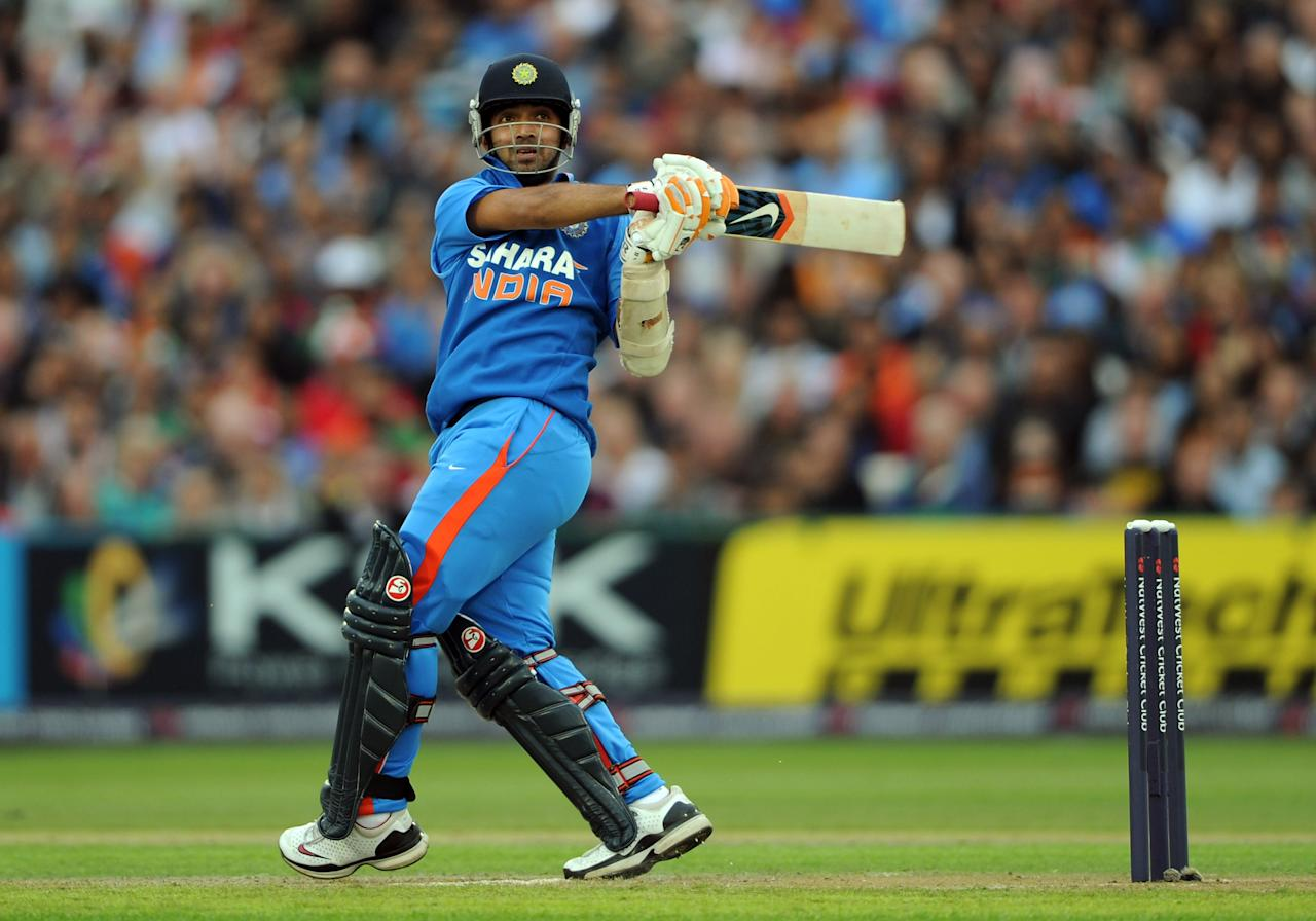 MANCHESTER, ENGLAND - AUGUST 31:  Ajinkya Rahane of India bats during the NatWest International Twenty20 Match between England and India at Old Trafford on August 31, 2011 in Manchester, United Kingdom.  (Photo by Gareth Copley/Getty Images)