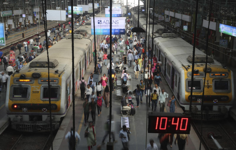 Indian commuters crowd the Churchgate railway station in Mumbai, India , Saturday, Feb 1, 2020. India's Hindu nationalist-led government on Saturday offered relief to taxpayers and vowed to spend billions to double farmers' incomes, upgrade infrastructure, health care and industry to boost the lowest economic growth in a decade. (AP Photo/Rafiq Maqbool)