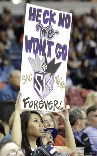 Sacramento Kings fan Rachel Biado shows her support for keeping the team in Sacramento during an NBA basketball game against the Utah Jazz, Saturday, Feb. 9, 2013, in Sacramento, Calif. Earlier in the week NBA Commissioner David Stern announced that the Seattle group led by investor Chris Hanson, which has reached an agreement to buy the Kings, has formally filed for relocation with the league. (AP Photo/Rich Pedroncelli)