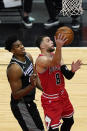 Chicago Bulls guard Zach LaVine, right, drive to the basket past Sacramento Kings center Hassan Whiteside during the first half of an NBA basketball game in Chicago, Saturday, Feb. 20, 2021. (AP Photo/Nam Y. Huh)