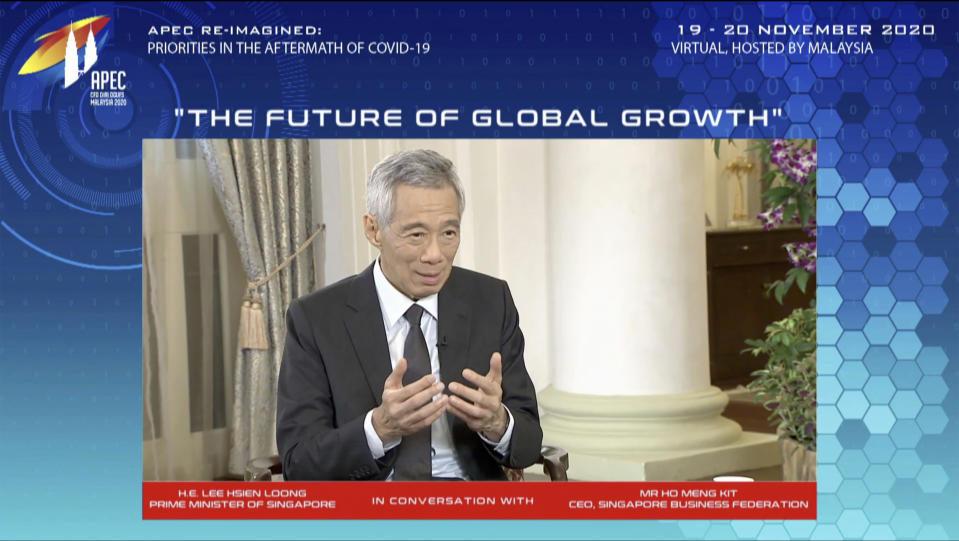 In this image from video released by APEC CEO Dialogues Malaysia 2020, Singapore's Prime Minister Lee HSein Loong, speaks at a CEO Dialogue forum via video link, ahead of the Asia-Pacific Economic Cooperation (APEC) leaders' summit, hosted by Malaysia, in Kuala Lumpur, Malaysia, Thursday, Nov. 19, 2020. (APEC CEO Dialogues Malaysia 2020 via AP)