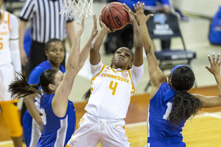 Tennessee guard Jordan Walker, center, goes to the basket between Middle Tennessee State forward Courtney Whitson and guard Anastasia Hayes during the first half of a college basketball game in the first round of the women's NCAA basketball tournament at the Frank Erwin Center in Austin, Texas, Sunday, March 21, 2021. (AP Photo/Stephen Spillman)