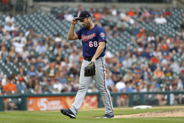 Minnesota Twins relief pitcher Matt Magill walks to the dugout in the eighth inning of a baseball game against the Detroit Tigers in Detroit, Saturday, June 8, 2019. (AP Photo/Paul Sancya)