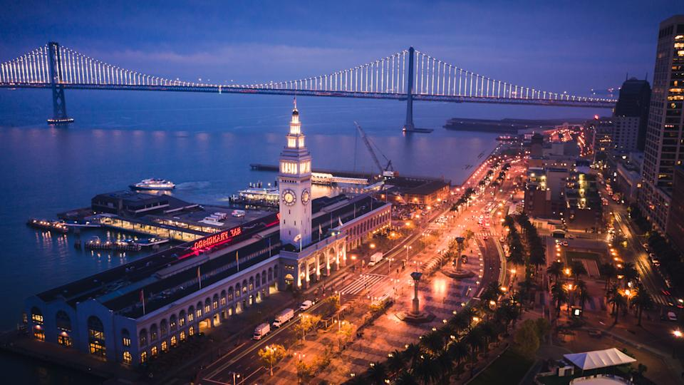 Aerial Cityscape View of San Francisco Ferry Building and Embarcadero at Dusk.