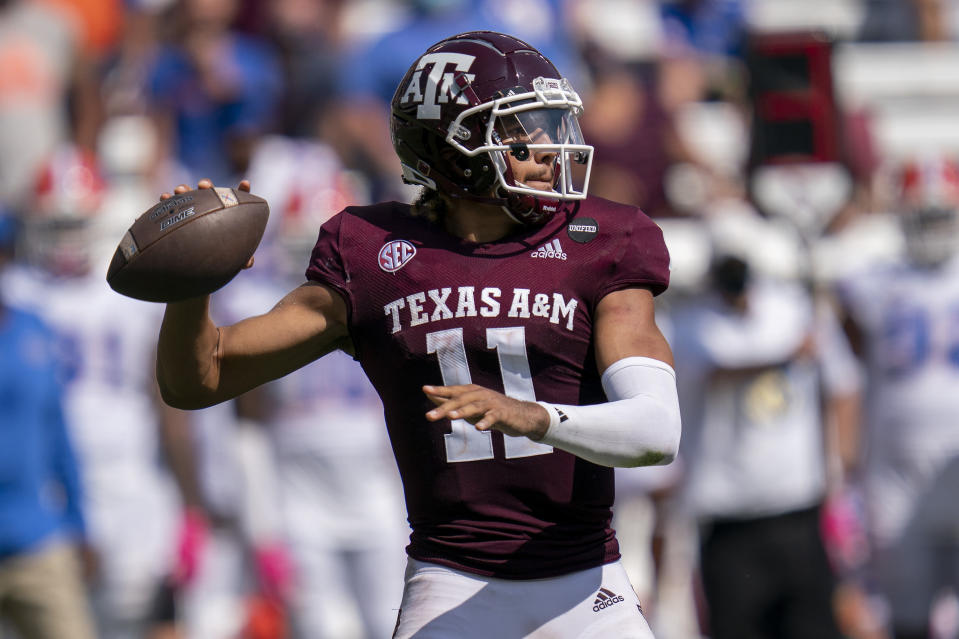 Texas A&M quarterback Kellen Mond (11) passes down field against Florida during the second half of an NCAA college football game, Saturday, Oct. 10, 2020. in College Station, Texas. A rare, four-year starting quarterback in the SEC, Mond has become the program's all-time passing leader while guiding the seventh-ranked Aggies to a 3-1 start. (AP Photo/Sam Craft)