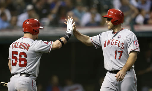 Los Angeles Angels' Chris Iannetta, right, is congratulated by Kole Calhoun after Iannetta scored on a sacrifice fly by J.B. Shuck in the fifth inning of a baseball game against the Cleveland Indians, Saturday, Aug. 10, 2013, in Cleveland. (AP Photo/Tony Dejak)
