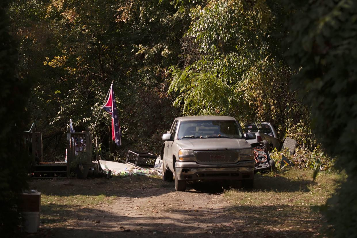 A Confederate flag hangs from a porch on a property in Munith, Mich., on Oct. 9, where law enforcement officials said suspects accused in a plot to kidnap Michigan Democratic Gov. Gretchen Whitmer met to train and make plans.