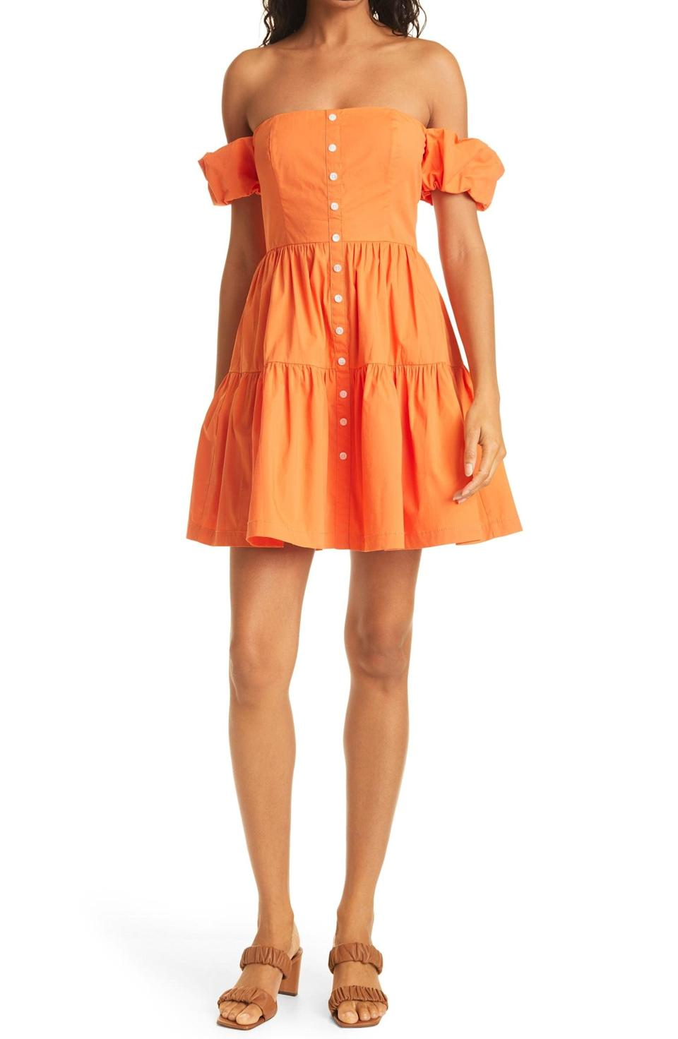 <p>We're ready to go on a vacation in this bright <span>Staud Elio Strapless Minidress</span> ($245).</p>
