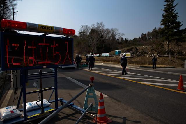 NAMIE, JAPAN - MARCH 10: Policemen stand at checkpoint in Namie, Fukushima Prefecture, prior to the second anniversary commemoration of the tsunami and earthquake on March 10, 2013 in Namie, Japan. Japan on March 11 will commemorate the second anniversary of the magnitude 9.0 earthquake and following tsunami, that claimed more than 18,000 lives. (Photo by Athit Perawongmetha/Getty Images)