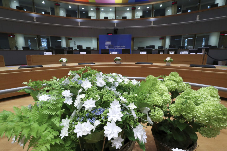 A meeting room especially adapted to adhere to physical distance guidelines for EU leaders for an upcoming EU summit at the European Council building in Brussels, Thursday, July 16, 2020. On Friday, July 17, 2020, leaders from the 27 European Union nations will meet face-to-face to try to carve up a potential package of 1.85 trillion euros among themselves. Due to coronavirus concerns, Friday's summit will be held in a larger-than-usual meeting room to meet social distancing requirements, the media will be kept to a minimum and there will be no group photo of the leaders. (Yves Herman, Pool Photo via AP)