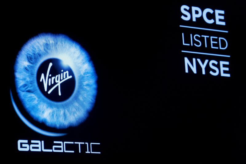 Virgin Galactic (SPCE) logo is displayed on a screen on the floor of the NYSE in New York