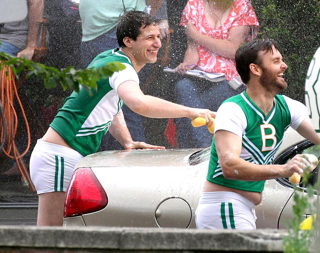 "In <em>real</em> life, ""Saturday Night Live"" alums Andy Samberg and Will Forte probably wouldn't be. a wearing a cheerleading uniform or b. participating in a car wash, but that's the fun of being an actor! Samberg -- who just announced he won't be returning to ""SNL"" next season -- got wet and wild on Tuesday on the set of ""Grown Ups 2"" in Boston. (5/29/2012)"