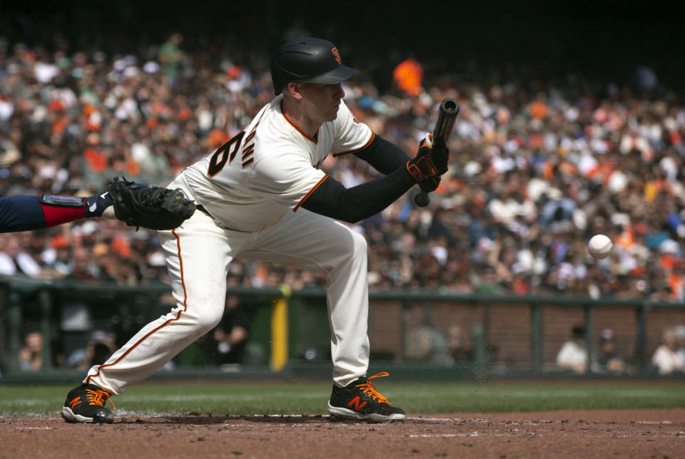 San Francisco Giants' Anthony DeSclafani lays down a sacrifice bunt against the Atlanta Braves during the third inning of a baseball game, Sunday, Sept. 19, 2021, in San Francisco. (AP Photo/D. Ross Cameron)