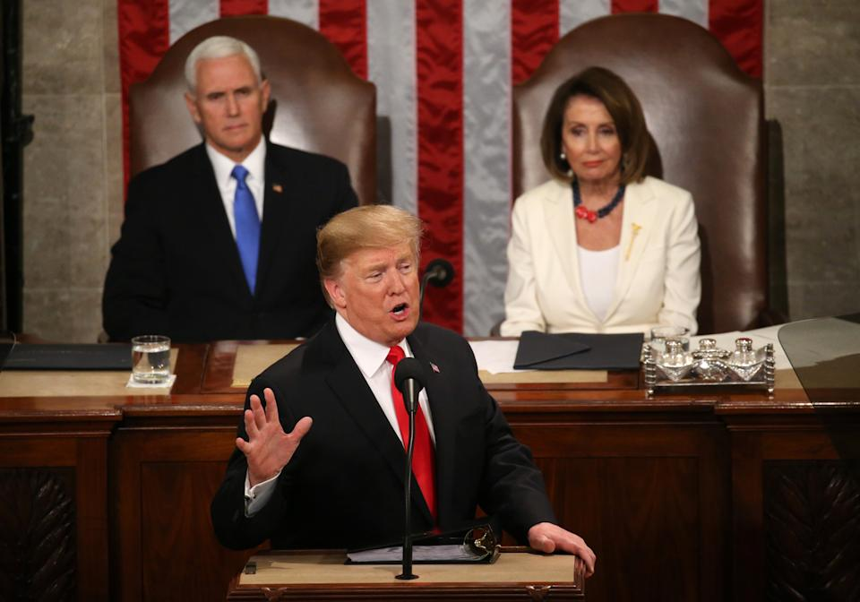 Vice President Mike Pence and Speaker of the House Nancy Pelosi (D-CA) listen as U.S. President Donald Trump delivers his second State of the Union address to a joint session of the U.S. Congress in the House Chamber of the U.S. Capitol on Capitol Hill in Washington, U.S. February 5, 2019. REUTERS/Leah Millis