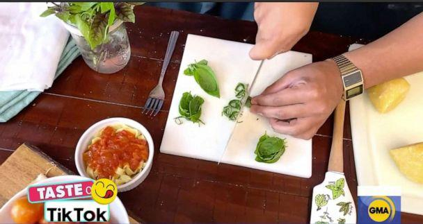 PHOTO: Mike Spurlock, aka Spurweezy Eats, showed 'GMA' how to chiffonade basil for pasta. (ABC News)
