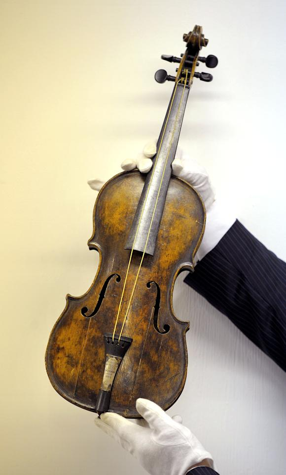 A violin, believed to be the one played by Titanic bandmaster Wallace Hartley, is displayed at auction house Henry Aldridge and Son in Devizes, England, Friday Oct. 18, 2013. The auction house, which specializes in Titanic memorabilia, expects the violin to fetch more than 200,000 pounds (US$323,300) when it goes on sale on Saturday. (AP Photo/PA, Tim Ireland) UNITED KINGDOM OUT NO SALES NO ARCHIVE