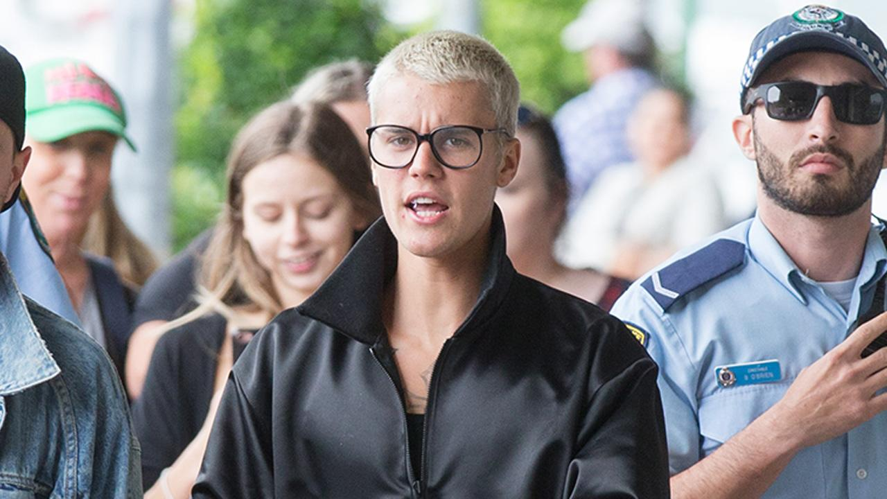 "Justin Bieber begs Aussie fans to stop ""acting like animals""."