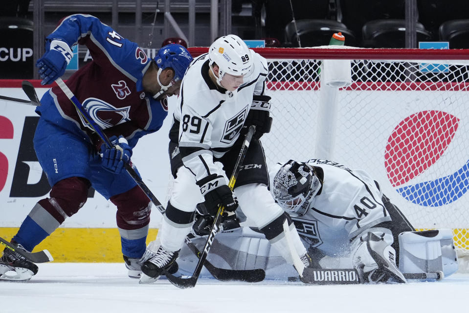 Colorado Avalanche center Pierre-Edouard Bellemare (41) scores a goal against Los Angeles Kings goaltender Calvin Petersen (40) as center Rasmus Kupari (89) defends during the first period of an NHL hockey game Wednesday, May, 12, 2021, in Denver. (AP Photo/Jack Dempsey)