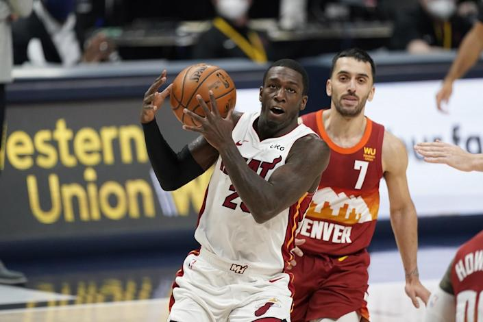 Miami Heat guard Kendrick Nunn controls the ball in front of Denver Nuggets guard Facundo Campazzo during a game in April.