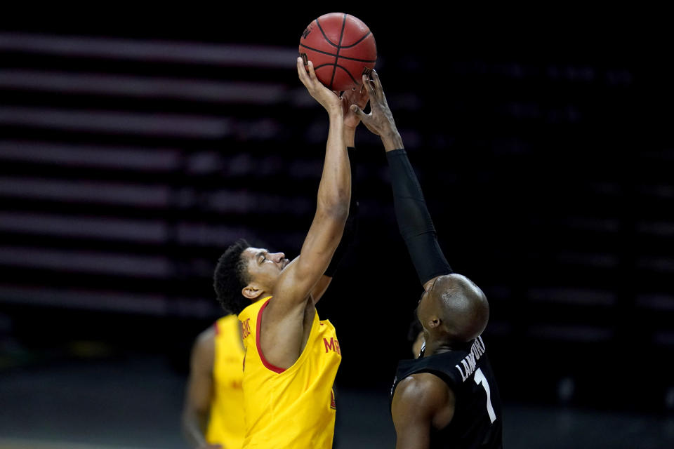 Michigan State guard Joshua Langford, right, blocks a shot by Maryland guard Aaron Wiggins during the second half of an NCAA college basketball game, Sunday, Feb. 28, 2021, in College Park, Md. Maryland won 73-55. (AP Photo/Julio Cortez)