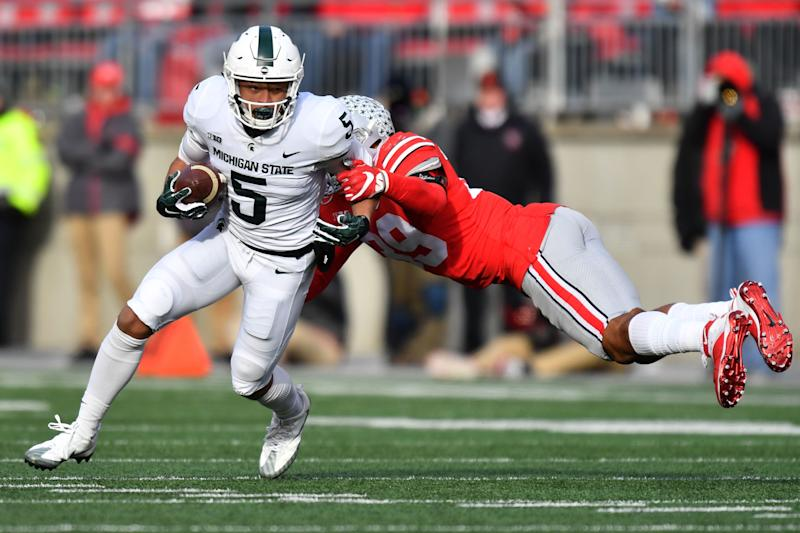 COLUMBUS, OH - NOVEMBER 11: Hunter Rison #5 of the Michigan State Spartans shakes off the tackle from Malik Harrison #39 of the Ohio State Buckeyes in the fourth quarter to pick up yardage at Ohio Stadium on November 11, 2017 in Columbus, Ohio. Ohio State defeated Michigan State 48-3. (Photo by Jamie Sabau/Getty Images)