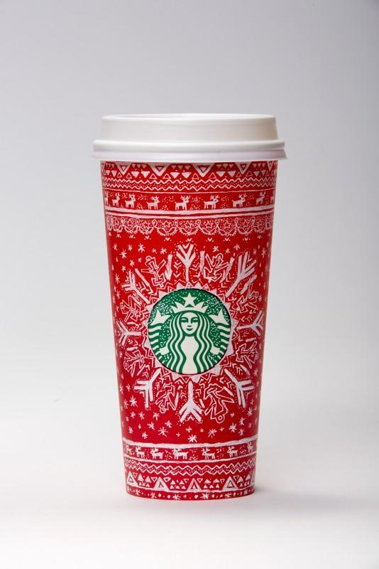 """<p>For Alisa, inspiration for her design came while drinking a gingerbread latte. """"The holiday mood made me try to draw on the Starbucks cup for the first time,"""" she said. Her design features snowflakes and reindeer patterned after a cozy sweater. </p>"""