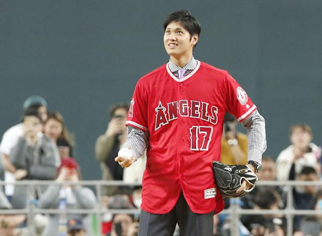 Shohei Ohtani wears an Angels jersey during a news conference in Sapporo, northern Japan Monday, Dec. 25, 2017. Los Angeles Angels-bound Ohtani bid farewell to fans of his former Japanese club Nippon Ham Fighters on Monday as he sets off to join his new team. (AP)