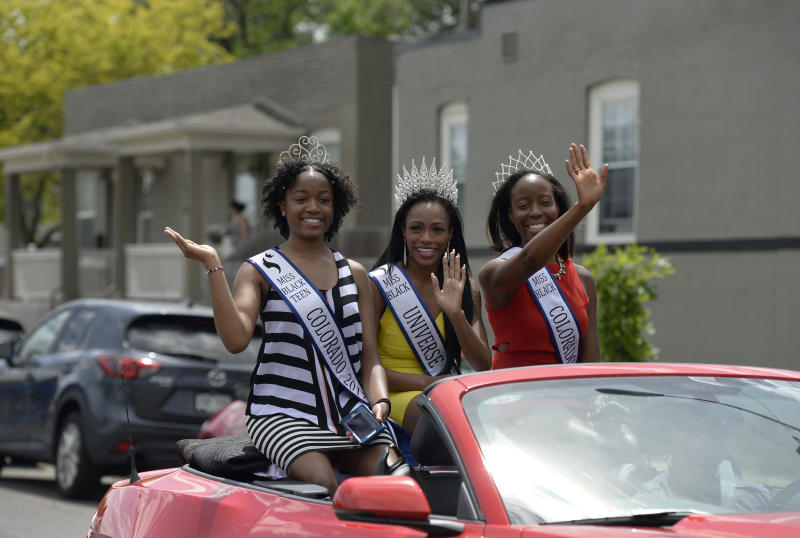 "DENVER, CO - JUNE 17: Miss Teen Black Colorado Genesis Oats, 17, left, Miss Black Universe 2017, Michaela Jones, 28, and Miss Black Colorado Universe Lesley Pace, 25, right, join participants in the Juneteenth Music Festival and parade as they make their way down E. 26th Ave. on June 17, 2017 in Denver, Colorado. Organizers say its one of Denver's longest running parades dating back to the 1950's where ""nearly 3,000 people march to honor the struggles and social progress achieved through marches and demonstrations organized for freedom, justice, and equality in our countrys history"". This year's theme for the event is Dream Big. (Photo by Kathryn Scott/The Denver Post via Getty Images)"