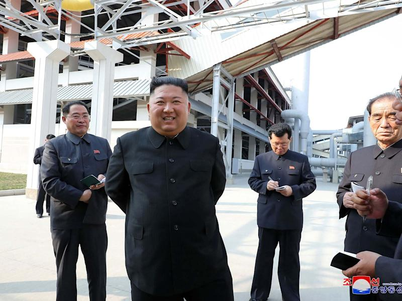 This picture, released from North Korea's official Korean Central News Agency (KCNA), shows North Korean leader Kim Jong Un visiting the completed Suchon phosphate fertilizer factory in South Pyongan Province: KCNA VIA KNS/AFP via Getty Image