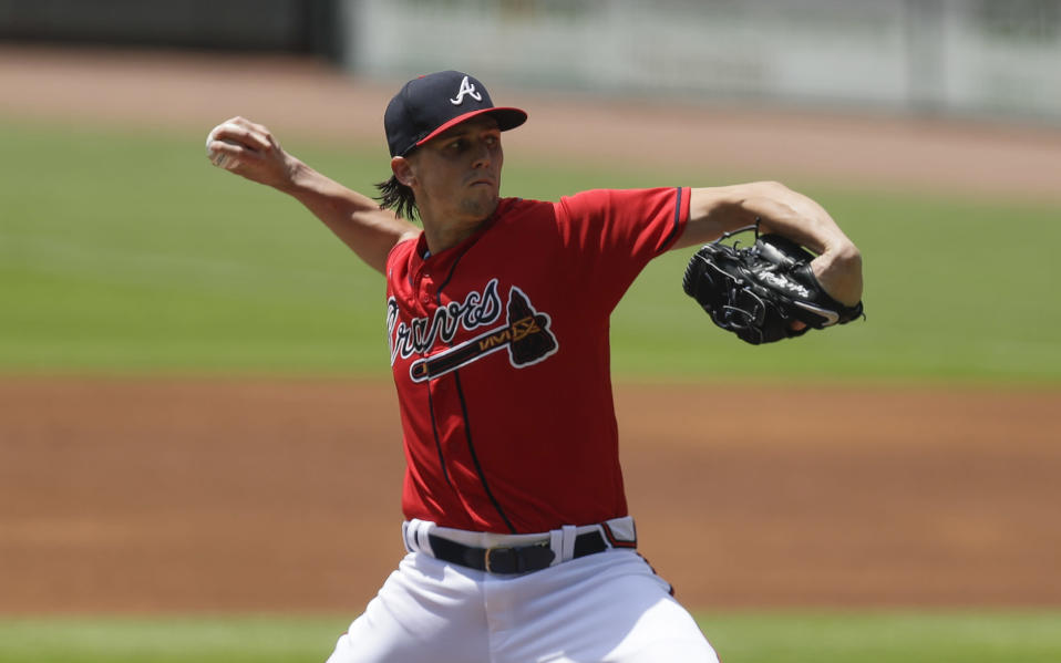 Atlanta Braves' starting pitcher Kyle Wright delivers in the first inning of a baseball game against the New York Mets, Sunday, Aug. 2, 2020, in Atlanta. (AP Photo/Brynn Anderson)