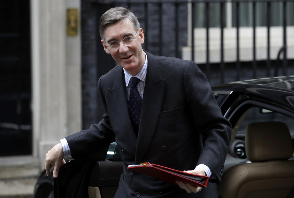 Britain's Leader of the House of Commons Jacob Rees-Mogg arrives for a Cabinet meeting at 10 Downing Street in London, Wednesday, Oct. 16, 2019. The European Union's chief Brexit negotiator says talks between the EU and Britain on the country's departure from the bloc are continuing after running through the night but that obstacles remain. (AP Photo/Kirsty Wigglesworth)