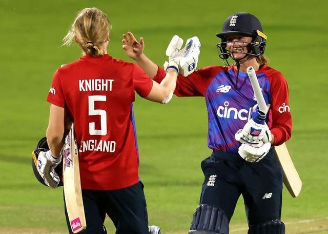 Danni Wyatt (right) and Heather Knight celebrate victory in the final match and the series