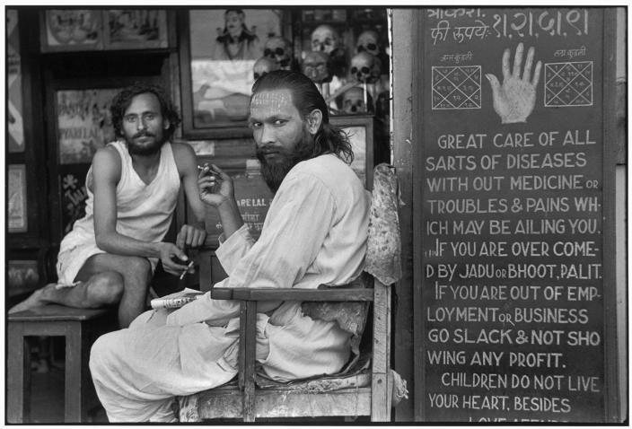 """<p>""""An astrologer's shop in the mill workers' quarter of Parel."""" Bombay, Maharashtra, India • 1947. (Photo: Henri Cartier-Bresson/Magnum Photos) </p>"""