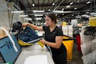Allissa Barragan folds and boxes up clothes at subscription rental company Le Tote's warehouse in Stockton