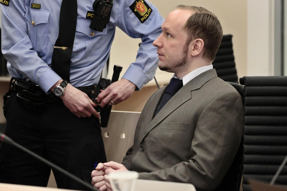 """Mass killer Anders Behring Breivik stands in the courtroom in Oslo, Norway Thursday April 26, 2012. Breivik has slammed a psychiatric report that declared him insane, insisting it was based on """"evil fabrications"""" meant to portray him as irrational and unintelligent. (AP Photo/Hakon Mosvold Larsen/NTB Scanpix, Pool)"""