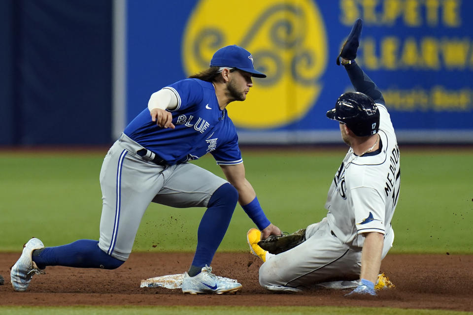 Toronto Blue Jays shortstop Bo Bichette tags out Tampa Bay Rays' Austin Meadows (17) attempting to steal second during the third inning of a baseball game Tuesday, Sept. 21, 2021, in St. Petersburg, Fla. (AP Photo/Chris O'Meara)