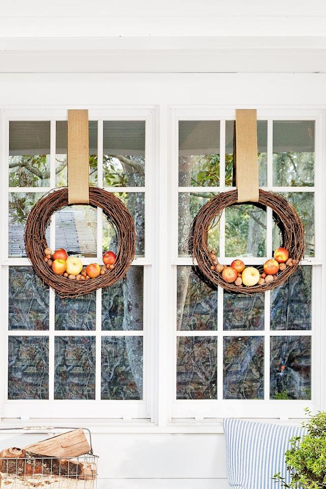 """<p>This festive decoration couldn't be simpler. Just add <a href=""""https://www.amazon.com/BcPowr-Artificial-Simulation-Decoration-Paintings/dp/B07LF5PMB6"""">faux apples</a> to the bottom of a grapevine wreath (or two!), then hang and admire.</p><p><a class=""""body-btn-link"""" href=""""https://www.amazon.com/Darice-2802-73-Grapevine-Wreath-18/dp/B07623DYL5/?tag=syn-yahoo-20&ascsubtag=%5Bartid%7C10050.g.1988%5Bsrc%7Cyahoo-us"""" target=""""_blank"""">SHOP GRAPEVINE WREATHS</a></p>"""